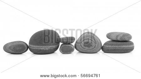 Stone selection in zen abstract design over white background.