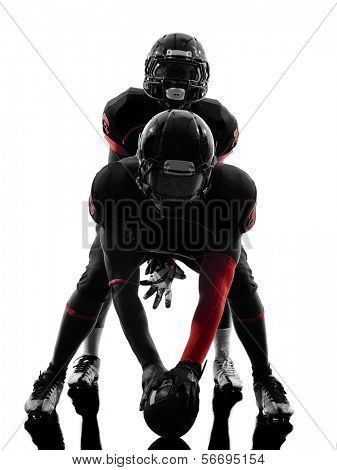 two american football players on scrimmage in silhouette shadow white background
