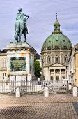 Castle Amalienborg with statue of Frederick V in Copenhagen, Denmark. The castle is the winter home of the Danish royal family poster
