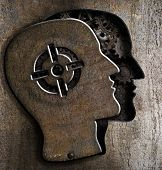 Human head with target mark on metal plate poster