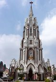 The steeple of Saint Mary's Cathedral stands over the entrance to the church in Bengaluru. poster