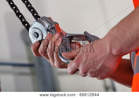 Close-up Of Male Hands And Lifting Hook
