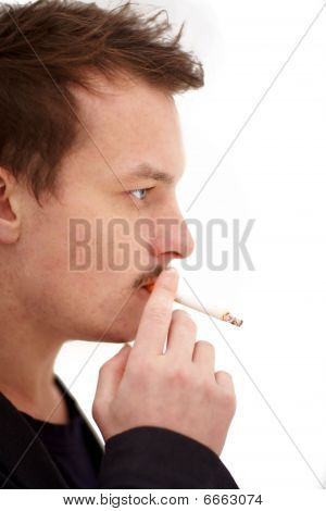 Modern Young Man Smoking A  Cigarette