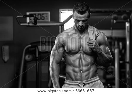 Portrait Of A Physically Fit Young Man In A Healthy Club