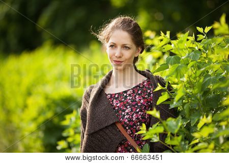 Beautiful Happy Woman In A Dress And Cardigan