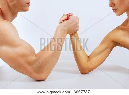 A Man And Woman With Hands Clasped Arm Wrestling, Isolated On White