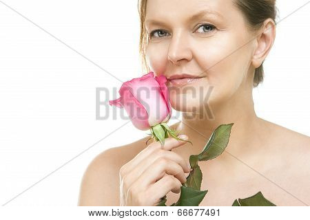 Attractive Mid Adult Woman, Female Face Of Beautiful Caucasian With A Pink Rose