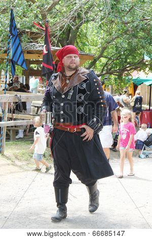 MUSKOGEE, OK - MAY 24: A man dressed as a pirate stops to talk during the Oklahoma 19th annual Renaissance Festival on May 24, 2014 at the Castle of Muskogee in Muskogee, OK.
