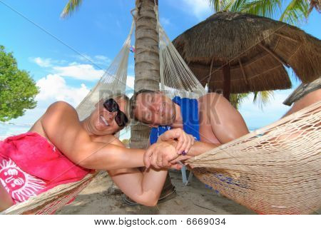 Couple on hammocks