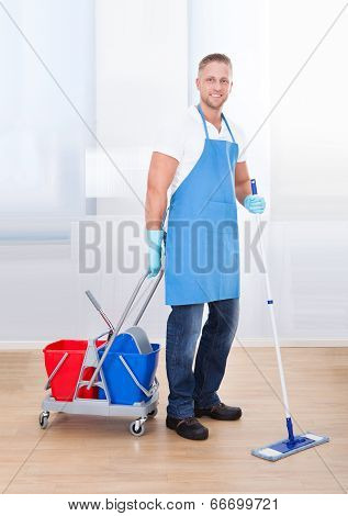 Janitor Cleaning Wooden Floors