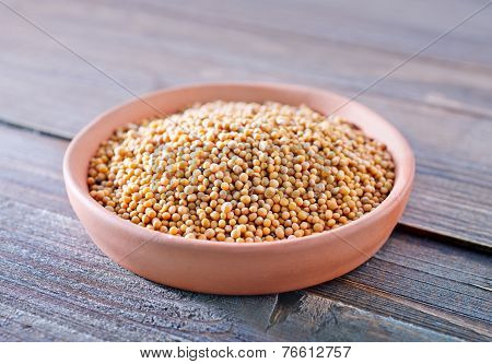 grain mustard in a bowl on the table poster