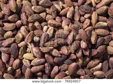 Unpeeled Pistachio Nuts  Peanuts Arranges As Background
