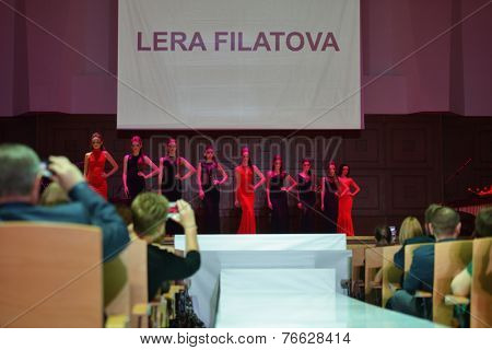 NOVOSIBIRSK, RUSSIA - NOVEMBER 15, 2014: Models dressed from Lera Filatova on the Grand defile of Novosibirsk Fashion Week. The event was held under the motto High Fashion & High Classics