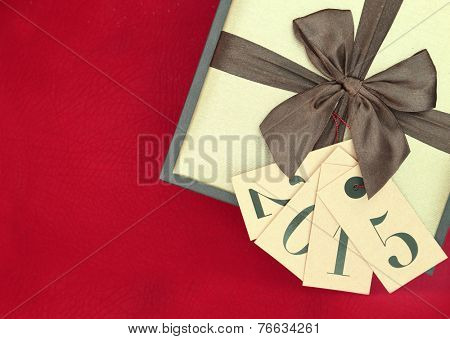Gift box and tags with new year 2015 isolated on red background