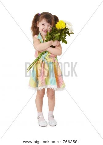 Happy Little Girl With Bouquet Of Flowers