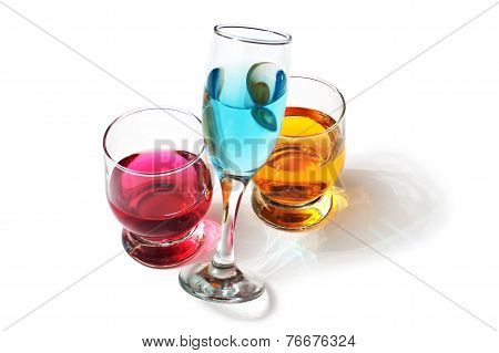 three glasses with drinks isolated on a white background