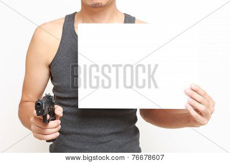 man with a message board threatens by a gun