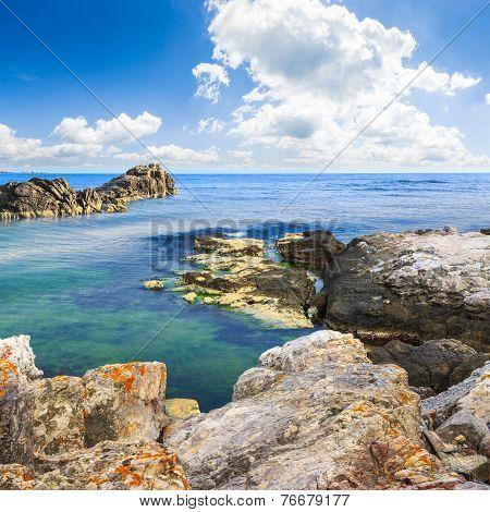 Sea Boulders Under Cloudy Sky