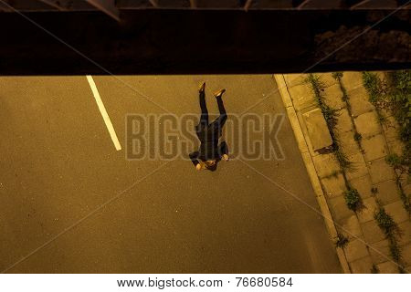 Suicide Girl Lying On A Street
