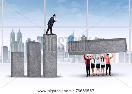 Entrepreneur Organizes His Workers