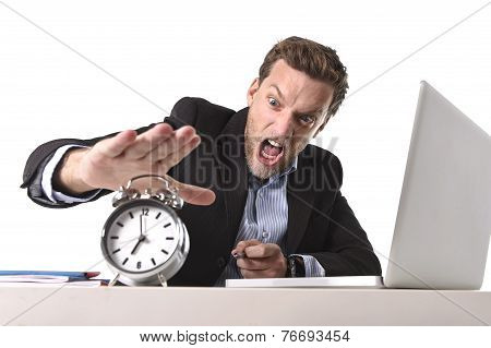 Exploited Businessman At Office Desk Stressed And Frustrated With  Alarm Clock In Out Of Time And De