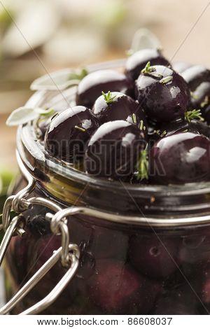 jar with pickled kalamata olives