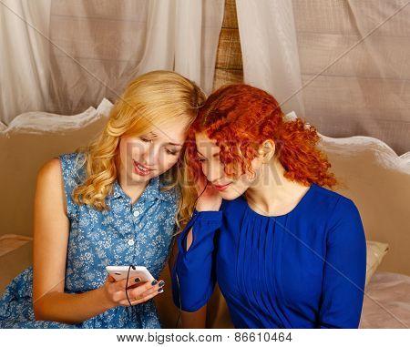Sisters Listening To Music On Headphones