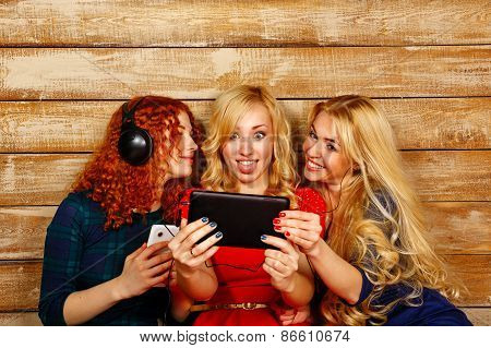 Sisters Listening To Music On Headphones And Make Selfie
