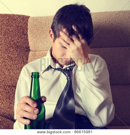Sad Young Man With A Beer