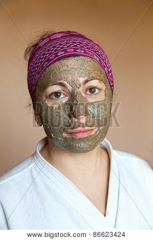 The woman in clay mask