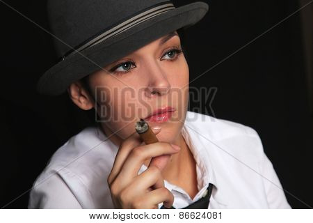 the girl keeps in fingers a cigar