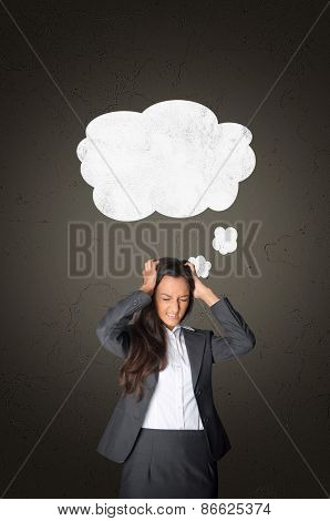 Stressed Young Businesswoman Holding her Head with White Blank Speech Bubble Above on Abstract Gray Gradient Background.