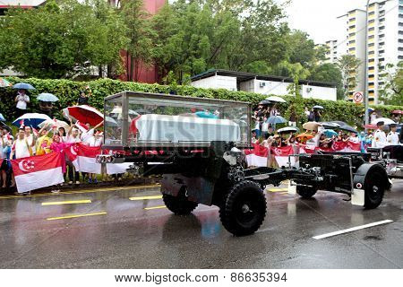 SINGAPORE MARCH 29:Gun carriage bearing the coffin of ex prime minister of Singapore, Mr Lee Kuan Yew driving pass on rainy day of state funeral Mar 29 Singapore 2015