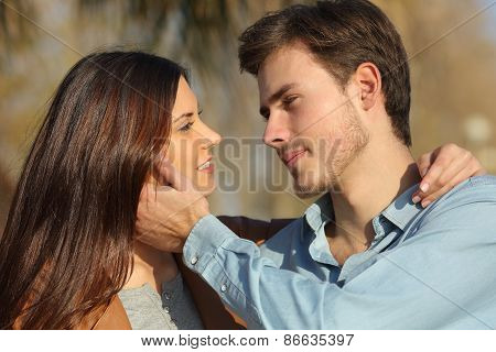 Couple In Love Ready To Kiss In A Park