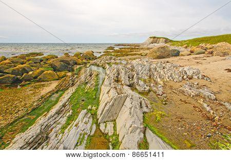 Rocks And Sand On A Remote Coast