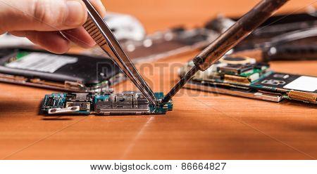Employee Repairing Fractured Phone