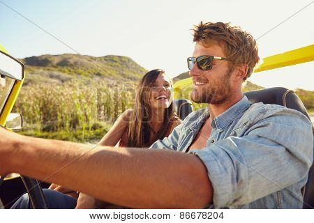 Cheerful Young Couple On A Road Trip