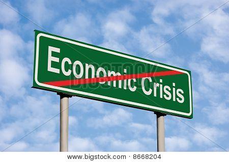 End Of Economic Crisis Green Road Sign Against Light Cloudscape Sky