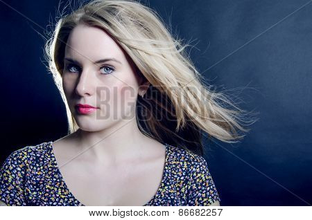 The Beautiful Blonde With Blue Eyes Seriously Looking At A Dark