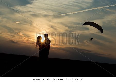 Couple Of Lovers Against Rising Sun