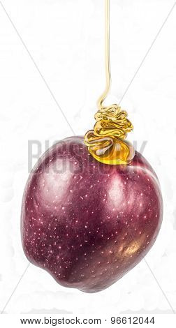 Honey drippin on a ripe red apple