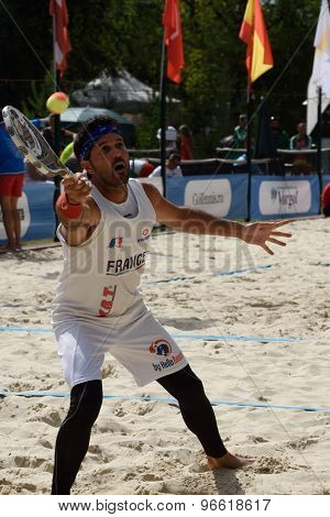 MOSCOW, RUSSIA - JULY 19, 2015: Patrice Bang of France in action during the ITF Beach Tennis World Team Championship. 28 nations compete in the event this year