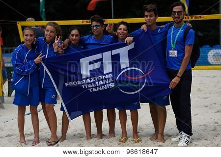 MOSCOW, RUSSIA - JULY 19, 2015: Junior team Italy with the flag of FIT during the ITF Beach Tennis World Team Championship. Italy become world champion in this first Junior Championship