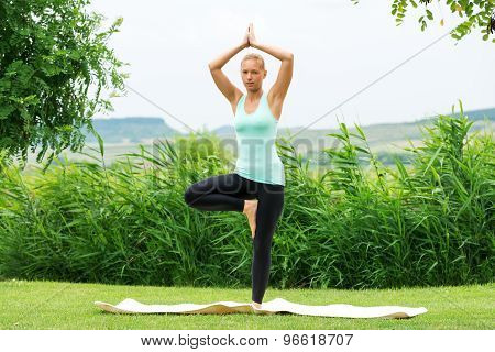 Woman Doing Tree Vrksasana Yoga Pose