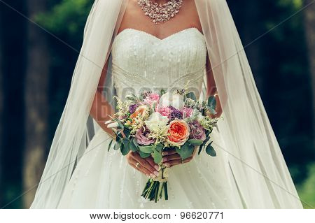 Bride Holding Big Wedding Bouquet