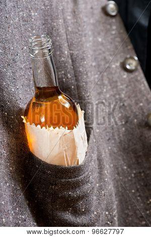 Hard Drinker Hides A Bottle