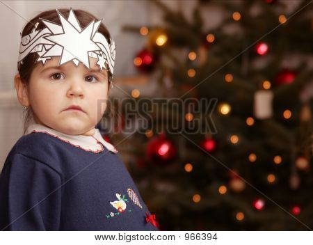 A Little Girl And Christmas Tree