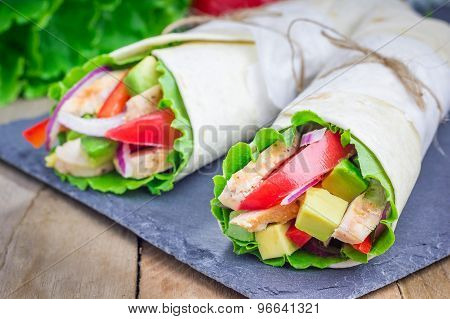 Tortilla Wraps With Roasted Chicken Fillet, Avocado, Tomato, Onion And Puprika