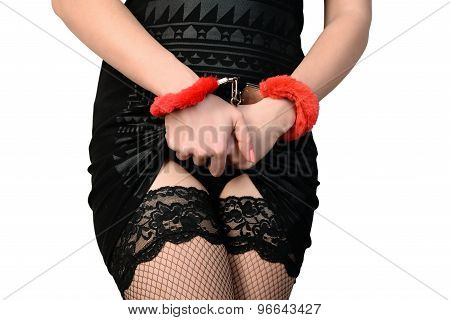seductive woman in handcuffs and stockings
