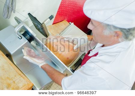 Man slicing meat with machine